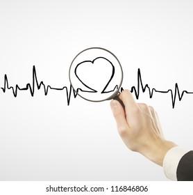 business man drawing chart heartbeat