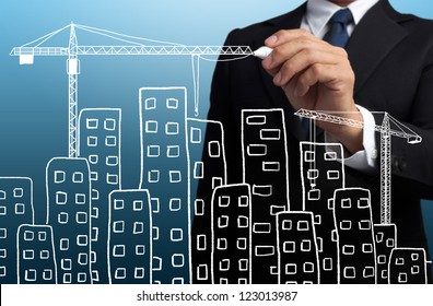 business man drawing construction site