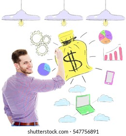 business man drawing a graphic with large money bag - Success Motivation Concept