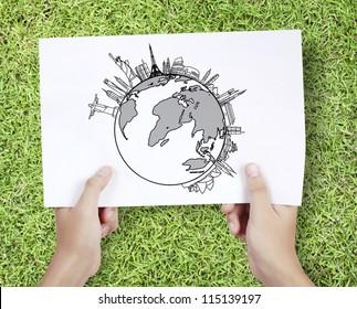 Business man drawing a World