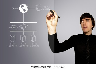 A business man draws a network topology diagram on a sheet of glass
