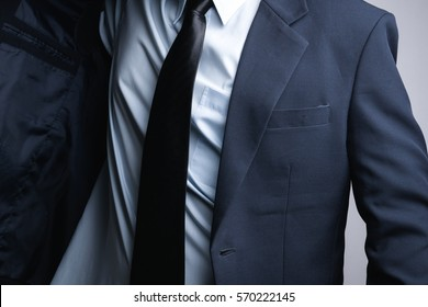 Business man dressing up on white background
