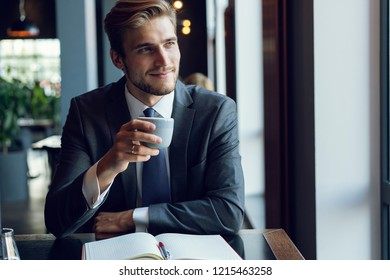 Business man drinking coffee in a cafe - coffee time