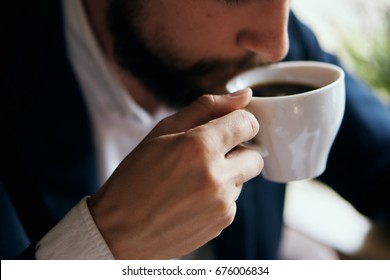 Business man drinking coffee in a cafe