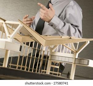 A business man explaining details about his architectural design