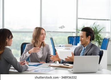 Business man explaining his idea to female investors