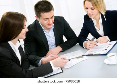 Business man explaining a new project to colleagues