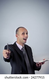 business man expressing positivity with pen and paper in hands and pointing to the camera isolated on blue with copy space