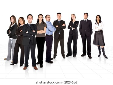 business man facing the camera with his team behind him