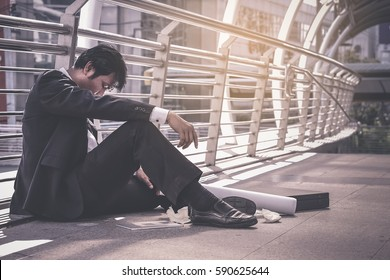 Business man failed to feeling hopeless, distraught, sad and discouraged in life. Concept failing businesses.