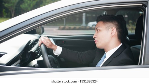 business man feel tired and depressed in the car