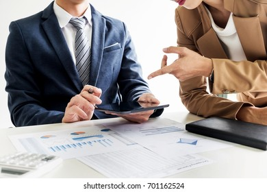business man financial inspector and secretary making report, calculating or checking balance. Internal Revenue Service inspector checking document. Audit concept at working with plan on office.