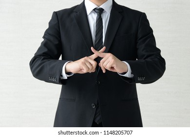 Business man with fingers crossed