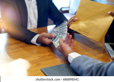 Business man give bribe to the officer concept corruption