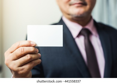 business man give a business card