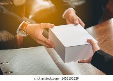 The business man give a present to the customer in the event. Gift for important people show how they take care each other's.