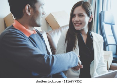 Business man is gladly smile shaking hand with female partner