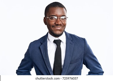 business man in glasses looks at the camera, smile