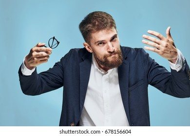 Business man with glasses on a blue background