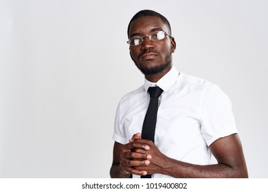 business man with glasses on a light background