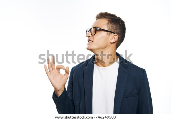 business man in glasses shows thumbs up signs on isolated background