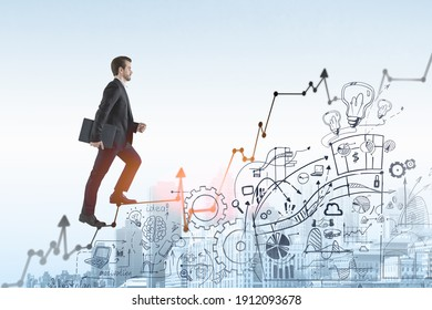 Business man go walk making step, businessman wear elegant black suit going up the stairs over ideas and concepts to built successful international business. business icons are drawn below the stairs