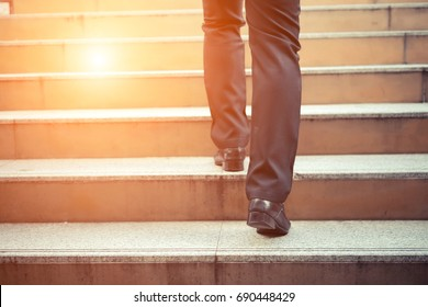 Business man going up the stairs  in a rush hour to work. Hurry time.