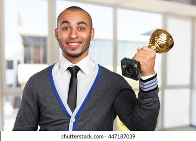 business man with gold cup