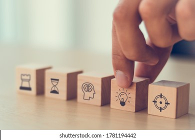 business man hand arranging wood block . icon of business strategy including element with goal, idea, leadership, management of time, Knowledge, Initiative, Human relations with copy space - Shutterstock ID 1781194442