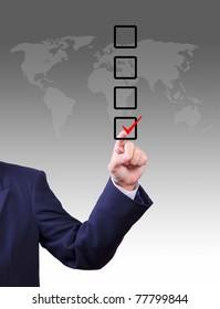 business man hand choose check mark on box