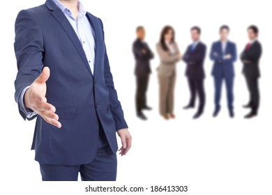 Business man with hand extended and business people