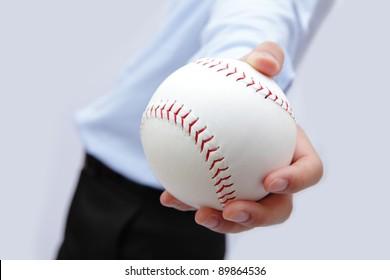 Business man hand holding a baseball