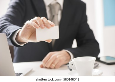 business man hand holding blank business card