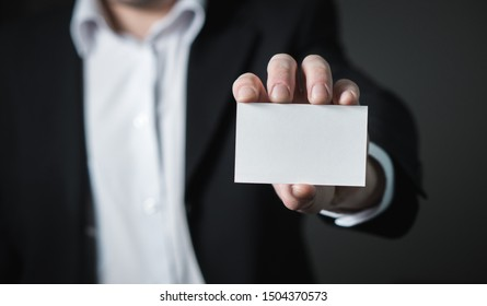 A Business Man Hand Holding A Business Card, Close Up Shot