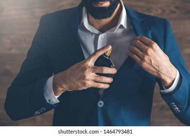 business man hand holding  perfume