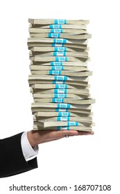Business man hand holding a tall stack of cash