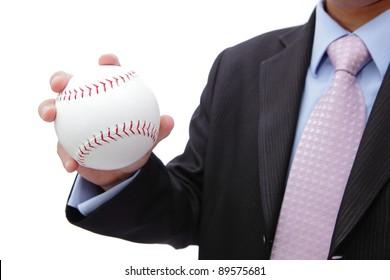 Business man hand holding white baseball