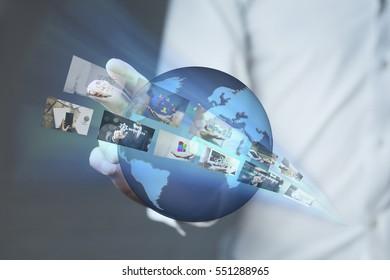 Business man hand  holding world.Technology concept