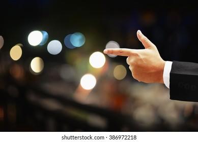 business man hand point on dark night