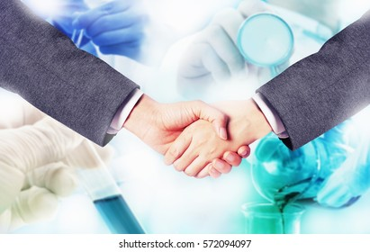business man hand shake with research medicine