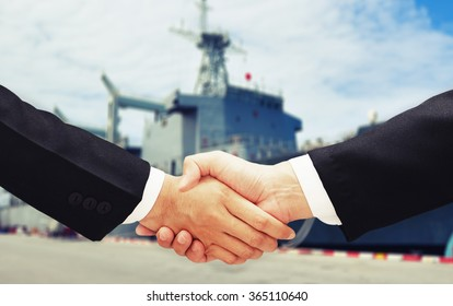 business man hand shake with ship blur background
