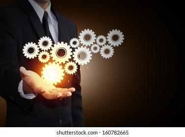 Equipo de exposición manual del hombre de negocios al trabajo en equipo como concepto