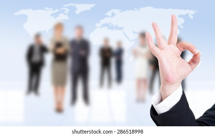 Business man hand showing ok or perfect gesture on business people background