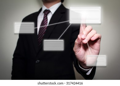 business man hand touching button on interface