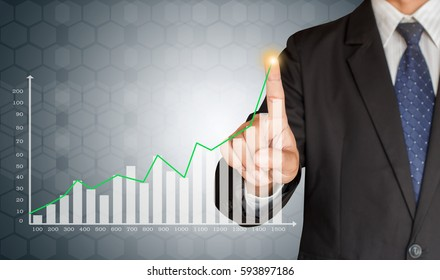 Business man hand touching a graph