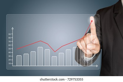 Business man hand touching a graph on blue background, representing business growth