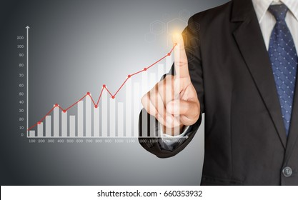 Business man hand touching a growing graph