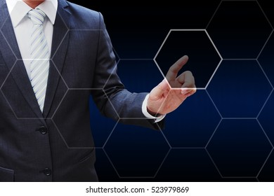 Business man hand touching virtual panel of icon polygon interface , business concept