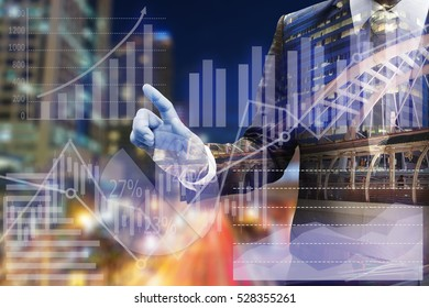 Business man hand touching virtual panel of pie chart and other chart , business concept