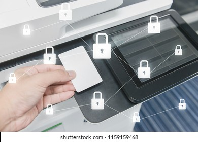 Business man hand is using smart card to printing document with locked key icon for data protection concept